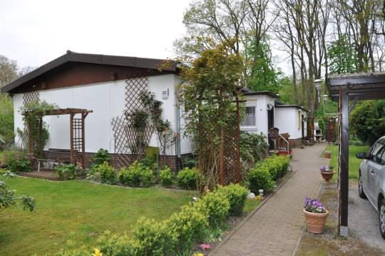 1-2 Fam.-Bungalow mit Keller, 2 Eingängen und neuem Dach! | PMBlifestyle